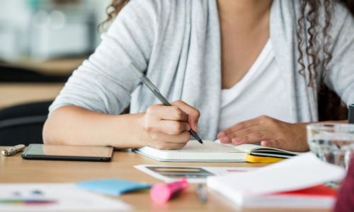 woman-at-work-taking-notes